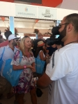 Nicole Scannell being interviewed at the Palm Bay booth at SOBE